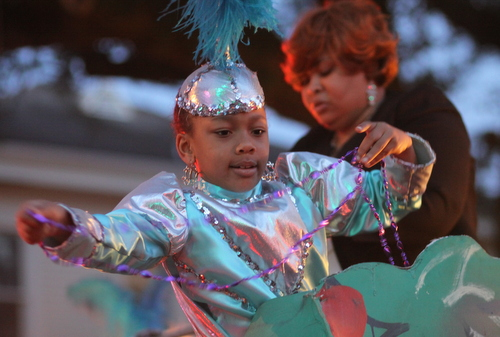"A young rider in the Krewe of Oshun's ""Yemoja and Emperor"" float. (Robert Morris, UptownMessenger.com)"