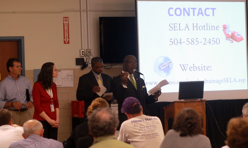 John Fogerty and Lori Wingate of the U.S. Army Corps of Engineers and Ron Spooner and Robert Jackson of the Sewerage and Water Board of New Orleans field questions from a crowd of 100 people about the next leg of the Napoleon Avenue drainage project on Tuesday.