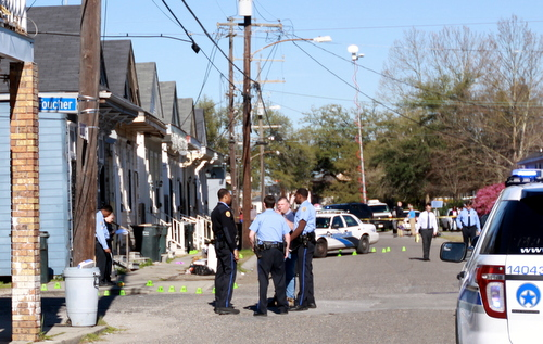 Police officers surround the intersection of Foucher and South Saratoga Streets on March 14, 2014, after two women were fatally shot. (Robert Morris, UptownMessenger.com)