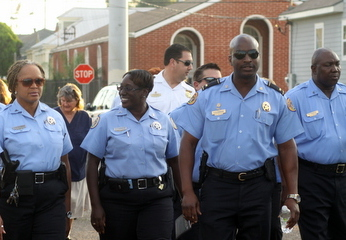NOPD Lt. Shaun Ferguson (second from right) marches in an anti-crime march through west Carrollton in September 2013. (UptownMessenger.com file photo by Sabree Hill)