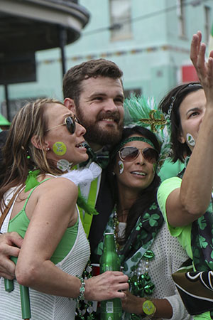 "New Orleans Saints' pro bowl punter Thomas Morestead takes a ""selfie"" with fans during Saturday's Irish Channel parade. Morestead and Saints' defensive coordinator Rob Ryan both marched in Saturday's parade."