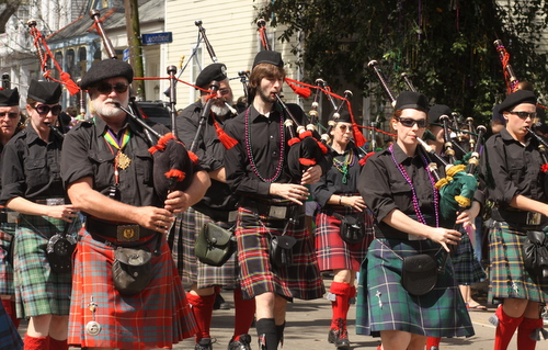 A line of bagpipes leads the Krewe of Okeanos on Magazine. (Robert Morris, UptownMessenger.com)