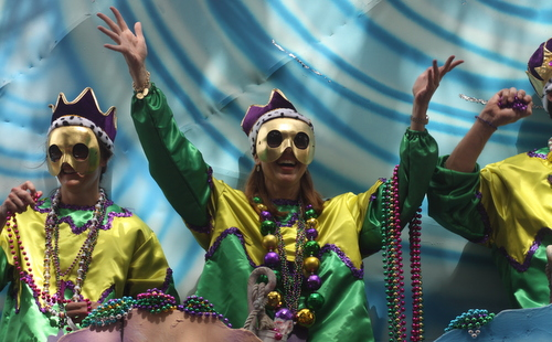 A rider in the Krewe of Okeanos laughs with the Magazine Street crowds. (Robert Morris, UptownMessenger.com)