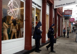 Police outside of American Apparel on Magazine Street after the March 6 armed robbery. (UptownMessenger.com file photo by Della Hasselle).