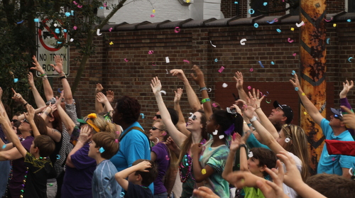 Confetti floats over the crowd at Henry Clay Avenue. (Robert Morris, UptownMessenger.com)