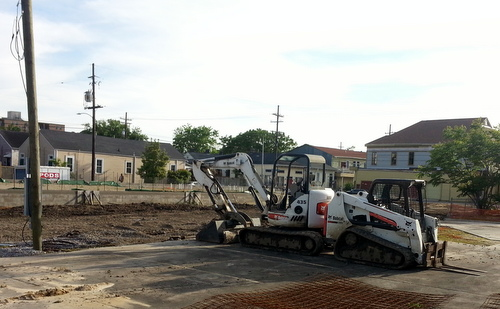 Newly delivered construction equipment sits at the site of the Martin Wine Cellar on Baronne Street on Tuesday evening. (Robert Morris, UptownMessenger.com)