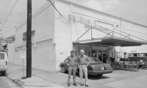 Cedric Martin (left) and David Y. Martin Jr. stand by the former Baronne Street location of Martin Wine Cellar in the mid 1980s. (submitted photo)