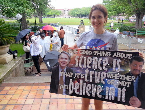 Alba Huddleston holds a sign she made honoring Neil deGrasse Tyson as she waits first in line Monday afternoon for his speaking appearance at Tulane later that night. (Robert Morris, UptownMessenger.com)