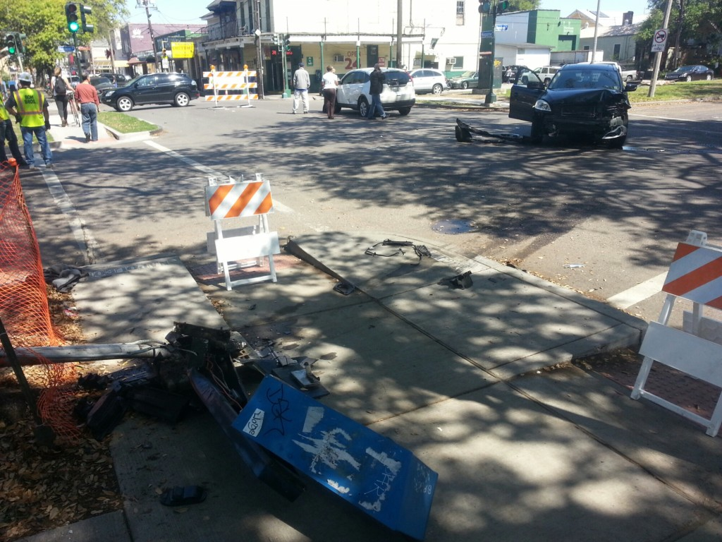 A public phone stand lays damaged after an April 10 crash at Magazine and Napoleon. It's still there. (UptownMessenger.com file photo)