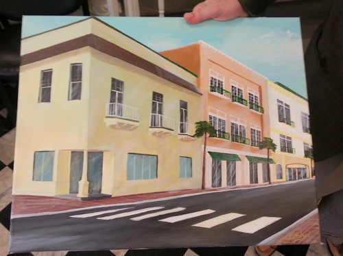Arnold Kirschman holds a painting of his plan for the buildings in the 4500 block of Freret Street. (Robert Morris, UptownMessenger.com)