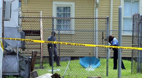 Police investigate a fatal shooting on Milan Street. (Robert Morris, UptownMessenger.com)