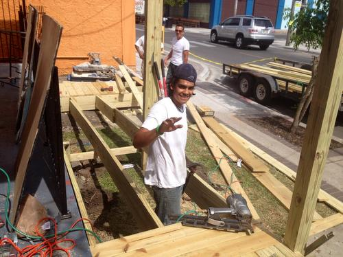 A volunteer works on a new wheelchair ramp at the Freret Neighborhood Center. (photo via the Freret Neighborhood Center on Facebook)