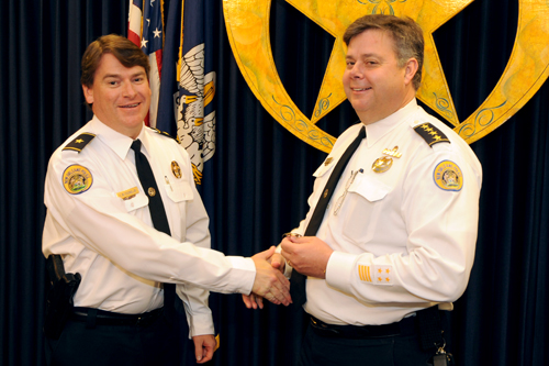 Commander Frank Young receives his promotion from NOPD Superintendent Ronal Serpas on Friday morning. (photo courtesy of NOPD Sgt. Walter Powers)