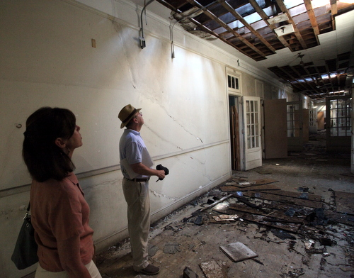 Barbara Griffin and John Wettermark of the International School of Louisiana examine roof damage on the third floor of the Priestley building. (Robert Morris, UptownMessenger.com)