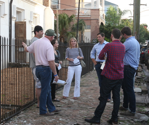 Jess Bourgeois of the proposed Lula restaurant and distillery and his wife (both center) speak with owners of Courtyard Brewery (left) and Barrel Proof bar (right) outside Felicity Church following Monday night's meeting of the Coliseum Square Association. (Robert Morris, UptownMessenger.com)