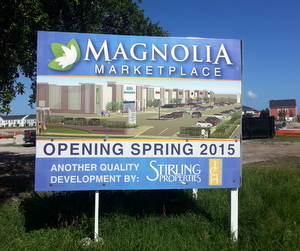 A sign on the Magnolia Marketplace site promises a 2015 grand opening. (Robert Morris, UptownMessenger.com)