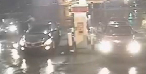 A still image from surveillance video released by the New Orleans Police Department shows the driver of the red PT Cruiser on the right getting into the Infiniti G35 on the far left before driving off in it.