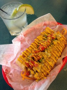 Dat Dog's Alligator Sausage and a Caipirinha, the national drink of Brazil. Both are available at Dat Dog this week during World Cup games.