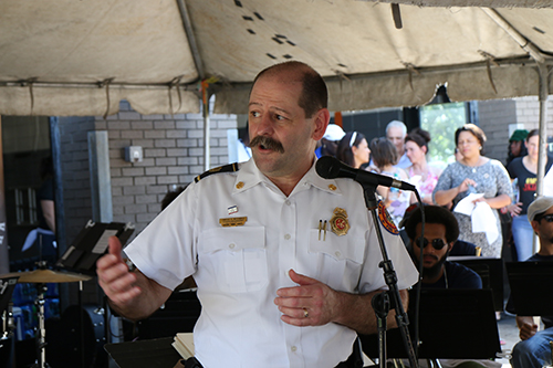 Timothy McConnell, chief at the Central City Fire Station, addressed the crowd before the Orchestra performed. (Zach Brien, UptownMessenger.com)