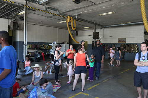 Attendees found relief from the 90 degree heat inside the fire station. (Zach Brien, UptownMessenger.com)