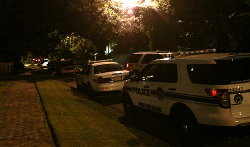 New Orleans Police vehicles line the 1100 block of Soniat Street after a home invasion was reported there Tuesday evening. (Robert Morris, UptownMessenger.com)