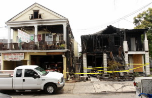 Two buildings burned early Wednesday morning in the 800 block of Cadiz. (Robert Morris, UptownMessenger.com)