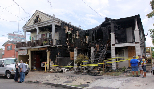 Neighbors and supporters discuss damage to houses in the 800 block of Cadiz Street. (Robert Morris, UptownMessenger.com)