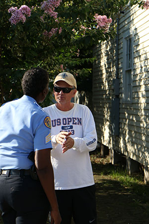 Sgt. Yolanda Jenkins (left) and Chris Barbe (right), a new uptown resident, talk before Wednesday's crime walk began. (Zach Brien, UptownMessenger.com)
