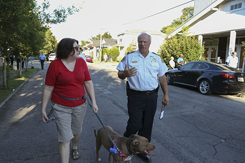 Captain Bob Bardy (right), discusses crime cameras with Meredith McLannhan and her dog Rosie (left). (Zach Brien, UptownMessenger.com)