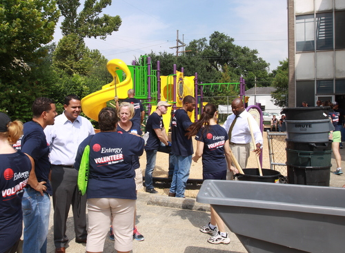 Dozens of Entergy volunteers are joined by City Councilmen Jared Brossett and Jason Williams as they prepare the playground at the former Benjamin Banneker campus for KIPP Believe students to move in next week. (Robert Morris, UptownMessenger.com)