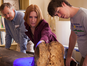 Egyptologist Melinda Nelson-Hurst (center) examines a coffin housed at Tulane University. (photo by Rene Guitart for the Middle American Research Institute, reprinted with permission from Tulane University)