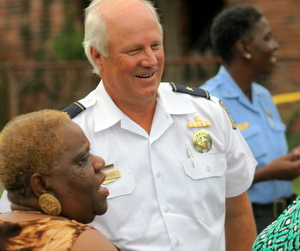 NOPD Sixth District Commander Bob Bardy and Central City activist Barbara Lacen-Keller speak at a crime scene in August 2014. (Robert Morris, UptownMessenger.com)