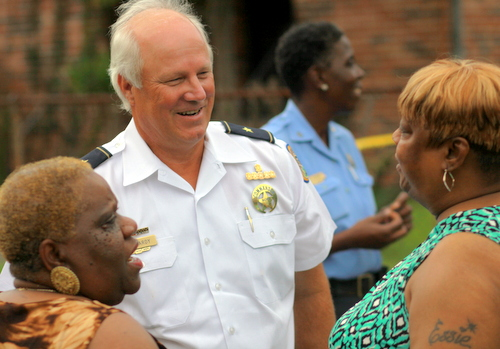 NOPD Sixth District Commander Bob Bardy and Barbara Lacen-Keller speak on a Central City sidewalk Wednesday. (Robert Morris, UptownMessenger.com)