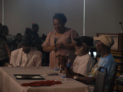 Roslyn J. Smith, center, mediates the conversation with the elders. The elders presented were Herbert Gettridge, far left, Joseph Jenkins, middle, and Isaac Edwards, near right. (Zach Brien, UptownMessenger.com)