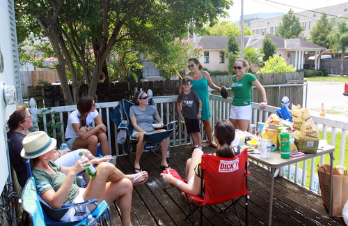 "A group of ""football wives of New Orleans"" enjoys drinks on a back porch prior to the game. (Robert Morris, UptownMessenger.com)"