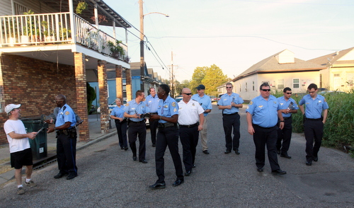 Commander Ronnie Stevens and members of the NOPD Sixth District walk on South Saratoga Street, steps between the scenes of two fatal shootings this year. (Robert Morris, UptownMessenger.com)