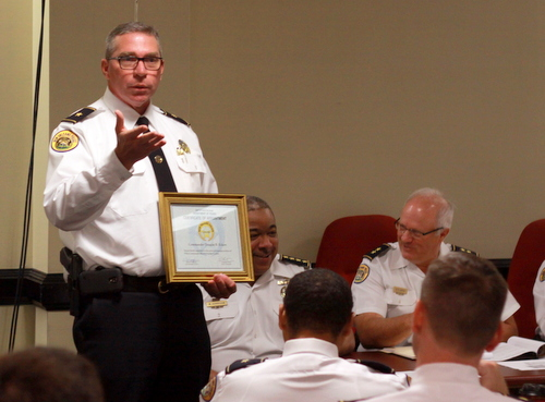 Commander Doug Eckert accepts his promotion to leader of the NOPD Crime Lab on Wednesday. (Robert Morris, UptownMessenger.com)