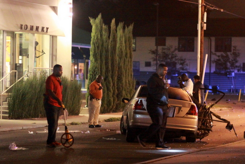 Police investigate the fatal crash on Magazine Street. (Robert Morris, UptownMessenger.com)