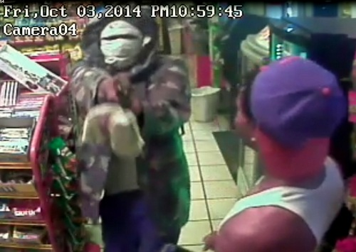 An image from surveillance video shows the armed robbery of the Discount Corner gas station on South Claiborne. (via NOPD)