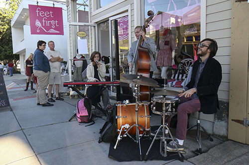 Jenna McSwain and the Celestial bodies performed outside of Feet First boutique. (Zach Brien, UptownMessenger.com)