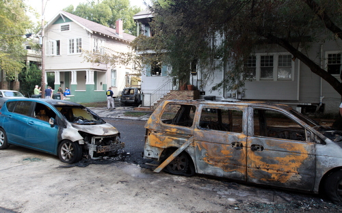 Cars across the street were also set ablaze in the Nov. 6 fire that displaced two families at the corner of Prytania and Constantinople. (Robert Morris, UptownMessenger.com)