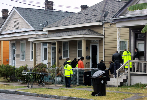 Police investigators examine the scene of the shooting on Fern Street. (Robert Morris, UptownMessenger.com)