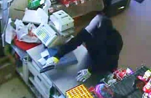 An image from Sunday morning's armed robbery of the Family Dollar on South Claiborne. (via NOPD)