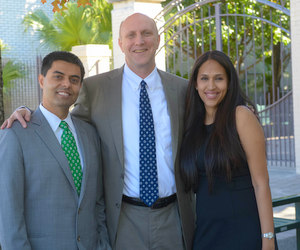 Dr. Tarun Jolly, Newman School leader Dale M. Smith, and Dr. Rupa Jolly (via Newman School)