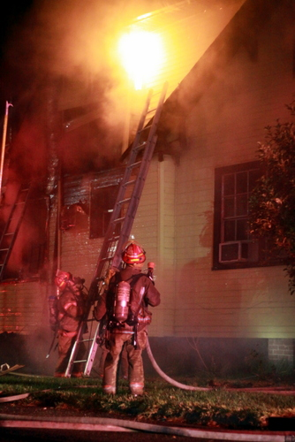 Firefighters battle a blaze in Broadmoor. (UptownMessenger.com)