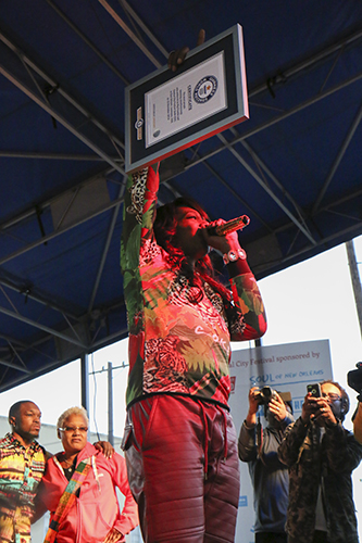 Big Freedia holds up her World Record plaque. (Zach Brien, UptownMessenger.com)