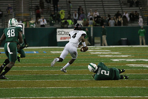 Munchie Legaux, Cincinnati quarterback and New Orleans native, jukes Tulane CB Darion Monroe on a scramble in the 4th quarter. (Zach Brien, UptownMessenger.com)