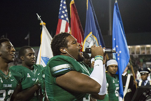Kenny Welcome, Tulane senior defensive tackle, sings the national anthem on Saturday night. (Zach Brien, UptownMessenger.com)