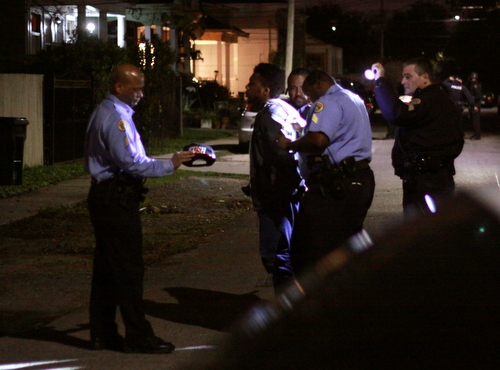Police take a suspect into custody Sunday night at Cadiz and Loyola. (Robert Morris, UptownMessenger.com)