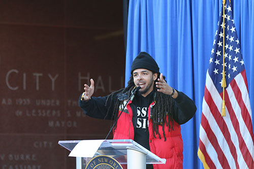 David Augustine Jr., the artist known as Dee-1, gives the keynote address during Monday's Martin Luther King celebration at New Orleans City Hall. (Zach Brien, UptownMessenger.com)